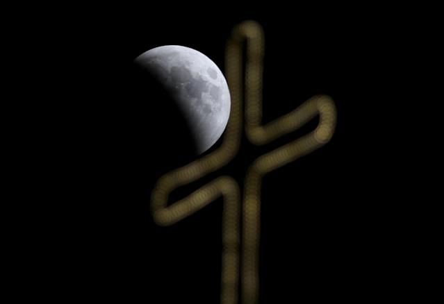 "<p>A ""Blood Moon"" is seen during a lunar eclipse over Jerusalem, July 27, 2018. (Photo: Ammar Awad/Reuters) </p>"