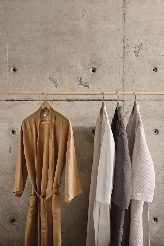 """<p>This <a href=""""https://www.popsugar.com/buy/HampM-Washed-Linen-Bathrobe-480334?p_name=H%26amp%3BM%20Washed%20Linen%20Bathrobe&retailer=www2.hm.com&pid=480334&price=50&evar1=casa%3Aus&evar9=46502352&evar98=https%3A%2F%2Fwww.popsugar.com%2Fhome%2Fphoto-gallery%2F46502352%2Fimage%2F46502422%2FHM-Washed-Linen-Bathrobe&list1=shopping%2Ch%26m%2Caccessories%2Chome%20decor%2Caffordable%20decor%2Cpoppy%20delevingne%2Chome%20shopping&prop13=api&pdata=1"""" rel=""""nofollow"""" data-shoppable-link=""""1"""" target=""""_blank"""" class=""""ga-track"""" data-ga-category=""""Related"""" data-ga-label=""""https://www2.hm.com/en_us/productpage.0660778014.html"""" data-ga-action=""""In-Line Links"""">H&amp;M Washed Linen Bathrobe</a> ($50) is so luxurious.</p>"""