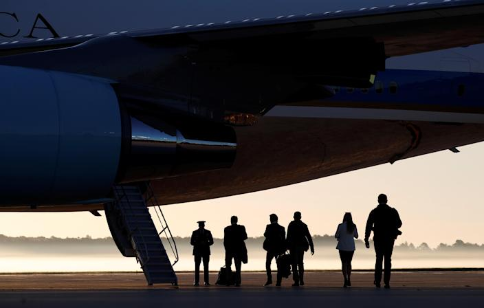 <p>On a misty morning, members of the White House press corps board Air Force One at Joint Base Andrews in Maryland, U.S., on their way to Las Vegas with U.S. President Donald Trum, Oct. 4, 2017. (Photo: Kevin Lamarque/Reuters) </p>
