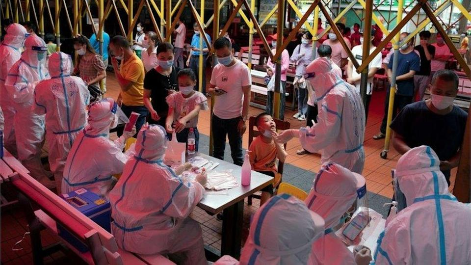 Residents line up for nucleic acid testing at a night market following a new case of the coronavirus disease (COVID-19) in Haikou, Hainan province, China 3 August 2021