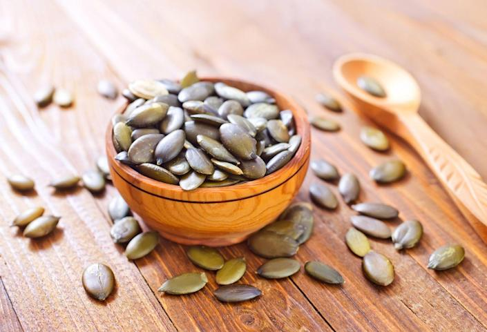 """<p>Pumpkin seeds are rich in blood pressure-lowering magnesium and <a href=""""https://www.prevention.com/food-nutrition/g20734052/zinc-deficiency-symptoms/"""" rel=""""nofollow noopener"""" target=""""_blank"""" data-ylk=""""slk:zinc"""" class=""""link rapid-noclick-resp"""">zinc</a>. Pumpkin seed oil is also a good way to get the seeds' benefits. Be warned: Store-bought pumpkin seeds are usually coated in salt, so choose the unsalted varieties or roast your own by baking them in a sheet pan for 20 minutes at 350 degrees. </p><p><strong>Try it:</strong> These <a href=""""https://www.prevention.com/food-nutrition/g20481920/7-healthy-pumpkin-seed-recipes/"""" rel=""""nofollow noopener"""" target=""""_blank"""" data-ylk=""""slk:healthy pumpkin seed recipes"""" class=""""link rapid-noclick-resp"""">healthy pumpkin seed recipes</a> will help you jazz things up when you're looking to get creative.</p>"""