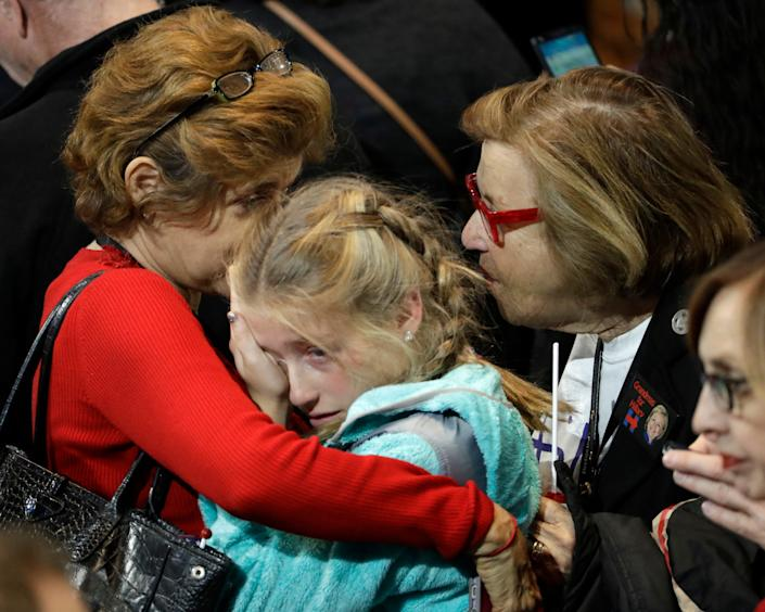 A young girl is comforted during Democratic presidential nominee Hillary Clinton's election night rally in the Jacob Javits Center lobby in New York on Nov. 8, 2016.