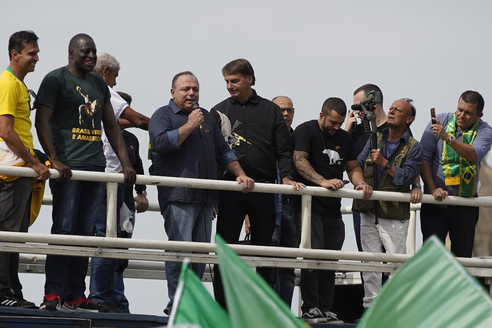 RIO DE JANEIRO, BRAZIL - MAY 23: President of Brazil Jair Bolsonaro and former Health Minister Eduardo Pazuello meets supporters at the Monument to the Dead of the Second World War during a motorcycle rally on May 23, 2021 in Rio de Janeiro, Brazil. (Photo by Wagner Meier/Getty Images)