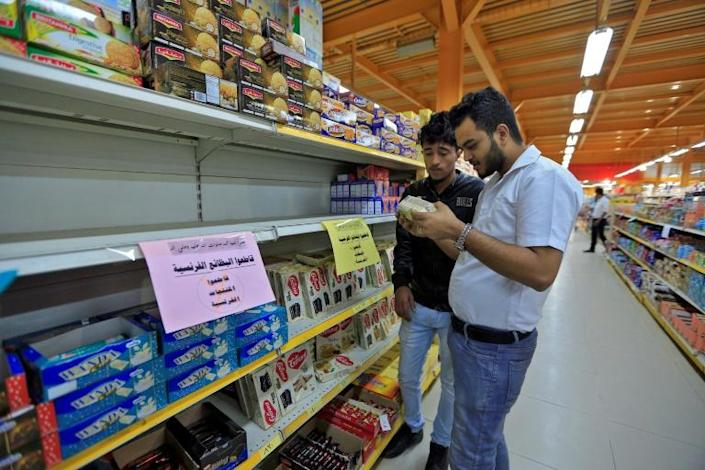 Signs were placed on shelves in Yemeni capital Sanaa calling on customers to boycott French goods