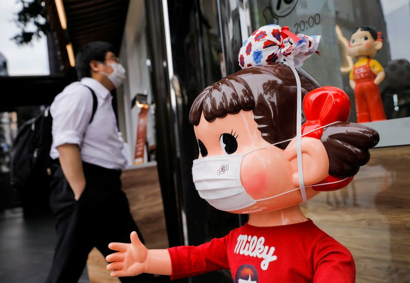 A mannequin known as 'Peko-chan' wearing a protective mask is displayed at Fujiya store, amid the coronavirus disease (COVID-19) outbreak, in Tokyo