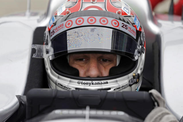 FILE - In this May 14, 2014, file photo, Tony Kanaan of Brazil, checks racing data as he waits in the pits during practice for the Indianapolis 500 IndyCar auto race at the Indianapolis Motor Speedway in Indianapolis. Kanaan will get to race 5 oval events, including the Indianapolis 500, in what will be called his farewell tour this upcoming IndyCar season. (AP Photo/Darron Cummings, File)