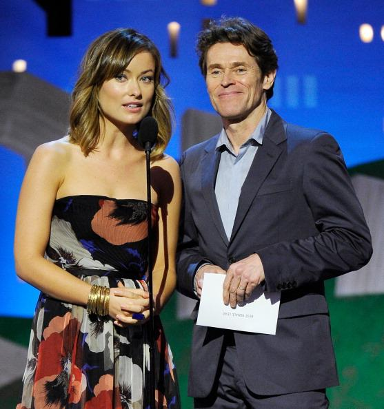 Actors Olivia Wilde (L) and Willem Dafoe speak onstage at the 2012 Film Independent Spirit Awards held at the Santa Monica Pier on February 25, 2012 in Santa Monica, California. (Photo by Kevork Djansezian/Getty Images)