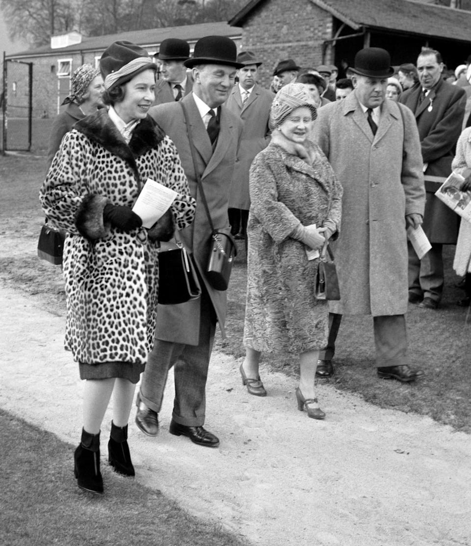 <p>The Queen, dressed in a leopard print coat, attends the Sandown Park race meeting with the Queen Mother. (PA Archive) </p>