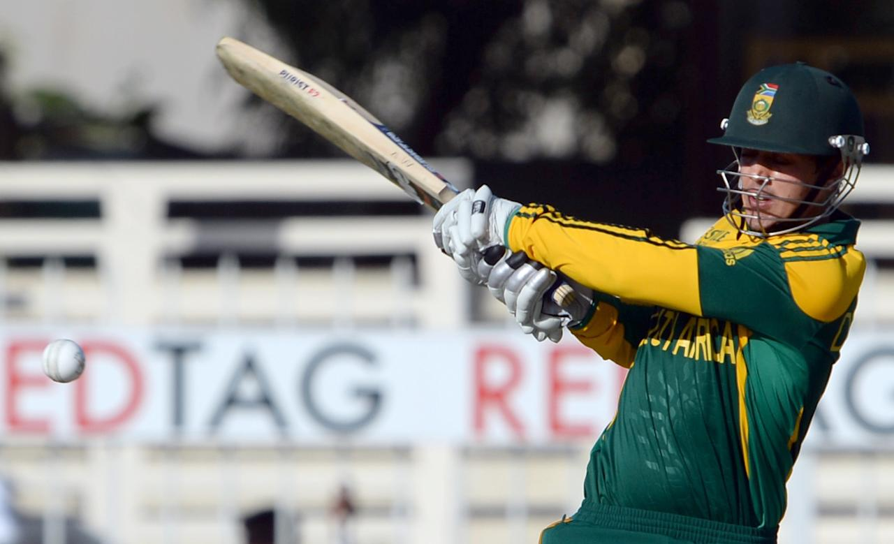 South African batsman Quinton de Kock plays a shot during the fifth and final day-night international at Sharjah Cricket Stadium in Sharjah on November 11, 2013. South Africa lead the five-match series 3-1. AFP PHOTO/Asif HASSAN