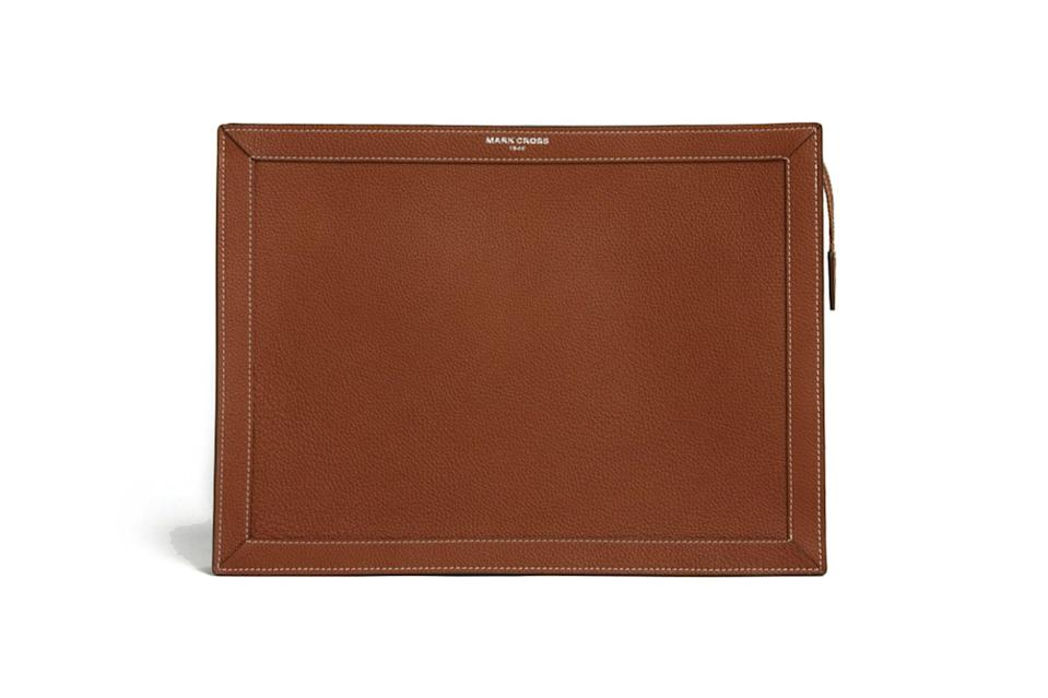 "$890, Mark Cross. <a href=""https://www.markcross.com/collections/mens-fall-2020/products/james-leather-portfolio-tumbled-grain-acorn-palladium?variant=32907097669741"" rel=""nofollow noopener"" target=""_blank"" data-ylk=""slk:Get it now!"" class=""link rapid-noclick-resp"">Get it now!</a>"
