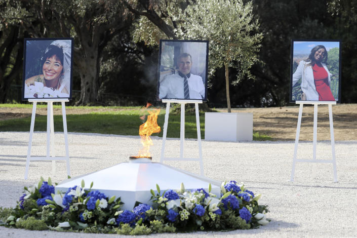 The portraits of, from the left, victims Nadine Devillers, Vincent Loques and Brazil's Simone Barreto Silva. Are pictured in Nice, southern France, Saturday Nov. 7, 2020, during a ceremony in homage to the three victims of an attack at Notre-Dame de Nice Basilica on October 29, 2020. Three people were killed in an Islamic extremist attack at Notre Dame Basilica in the city of Nice that pushed the country into high security alert. (Valery Hache; Pool via AP)