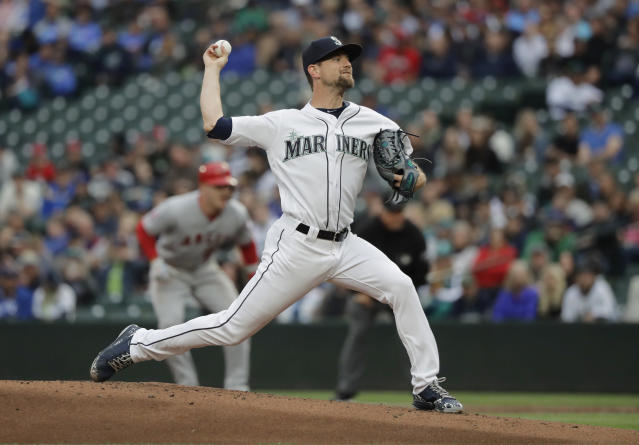 Seattle Mariners starting pitcher Mike Leake throws to a Los Angeles Angels batter during the first inning of a baseball game Tuesday, June 12, 2018, in Seattle. (AP Photo/Ted S. Warren)