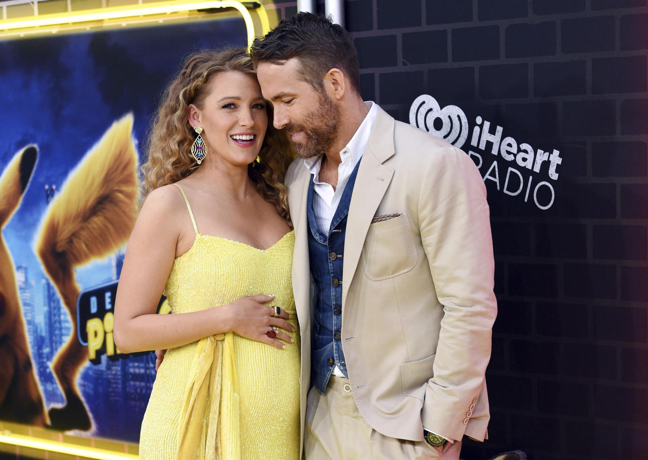 "Actor Ryan Reynolds, right, is joined by his pregnant wife, actress Blake Lively at the premiere of ""Pokemon Detective Pikachu"" at Military Island in Times Square on Thursday, May 2, 2019, in New York. (Photo by Evan Agostini/Invision/AP)"
