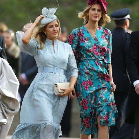 Ellie Goulding, left, arrives for the wedding - Credit: Getty
