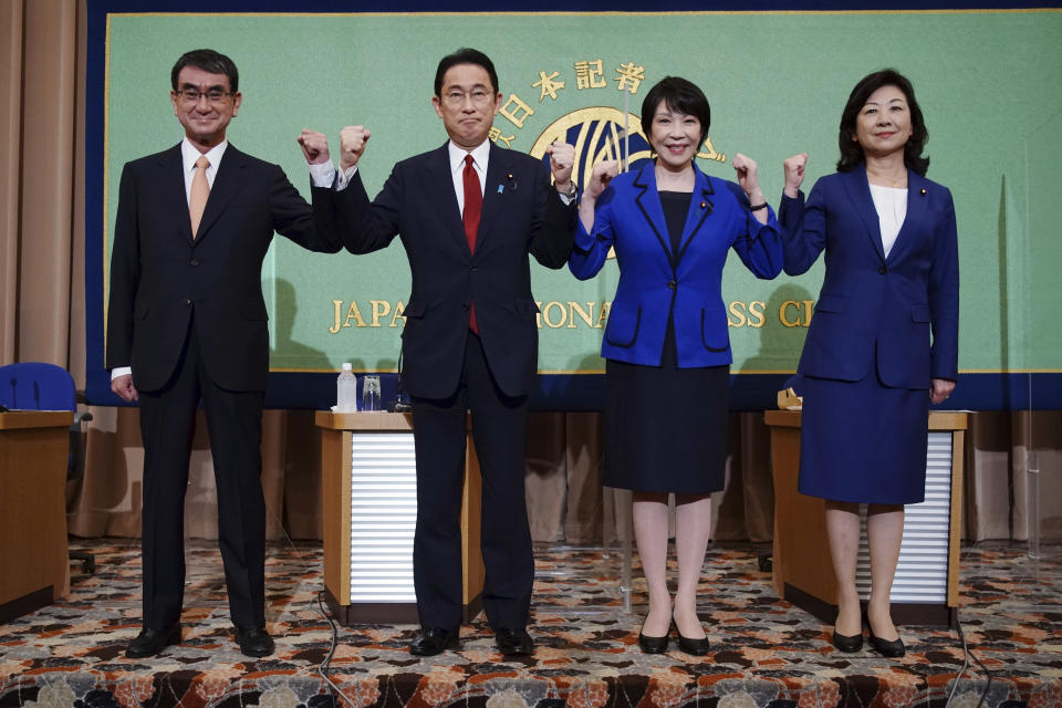 Candidates for the presidential election of the ruling Liberal Democratic Party pose prior to a debate session hosted by the Japan National Press Club Saturday, Sept. 18, 2021 in Tokyo. The contenders are, from left, Taro Kono, the cabinet minister in charge of vaccinations, Fumio Kishida, former foreign minister, Sanae Takaichi, former internal affairs minister, and Seiko Noda, former internal affairs minister. (AP Photo/Eugene Hoshiko, Pool)