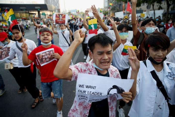 Myanmar citizens shout as they join with Thai protesters an anti-government protest in Bangkok