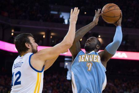 January 19, 2015; Oakland, CA, USA; Denver Nuggets forward J.J. Hickson (7) shoots the basketball against Golden State Warriors center Andrew Bogut (12) during the second quarter at Oracle Arena. Mandatory Credit: Kyle Terada-USA TODAY Sports