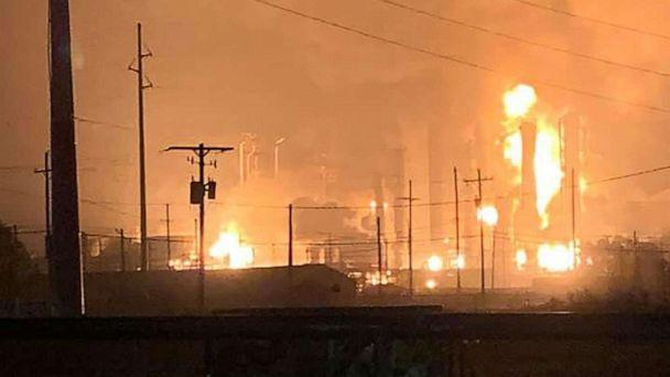 PHOTO: This handout image taken early on November 27, 2019 and released to AFP by Ryan Mathewson shows fire and flames following an explosion at a chemical plant in the Texas city of Port Neches. (Photo by Handout / Courtesy of Ryan Mathewson / AFP) (Handout/Courtesy of Ryan Mathewson/AFP )