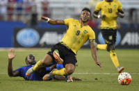 Jamaica forward Giles Barnes (9) is brought down by Haiti's Jean-Marc Alexandre, left, during the first half of a CONCACAF Gold Cup soccer quarterfinal, Saturday, July 18, 2015, in Baltimore. (AP Photo/Nick Wass)