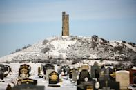 HUDDERSFIELD, UNITED KINGDOM - 2021/01/15: Snow covers the ground at Castle Hill in Huddersfield. Many parts of West Yorkshire are still covered with snow following heavy snowfall the previous day, which caused widespread disruption to travel. (Photo by Adam Vaughan/SOPA Images/LightRocket via Getty Images)