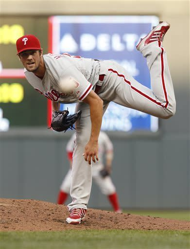 Philadelphia Phillies starting pitcher Cole Hamels throws against the Minnesota Twins during the third inning of a baseball game, Tuesday, June 11, 2013, in Minneapolis. (AP Photo/Genevieve Ross)