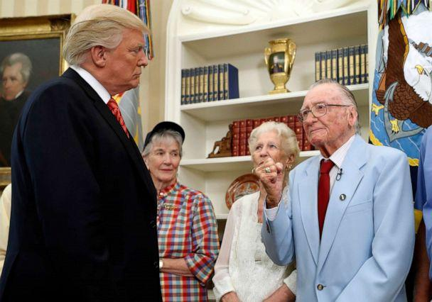 PHOTO: In this file photo taken on July 21, 2017, U.S. President Donald Trump listens to USS Arizona survivor Donald Stratton, right, during a meeting with survivors of the 1941 attack at Pearl Harbor, in the Oval Office of the White House in Washington. (Alex Brandon/AP)