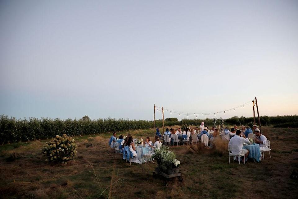 """""""A view of the prairie field surrounded by orchards in the most magical twilight,"""" Dean says. """"We couldn't have asked for better weather so pushing the date back last minute was well worth the added stress. Keeping the wedding small allowed us to pivot without a glitch."""""""