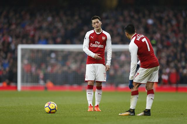"Mesut Ozil and <a class=""link rapid-noclick-resp"" href=""/soccer/players/alexis-sánchez"" data-ylk=""slk:Alexis Sanchez"">Alexis Sanchez</a> were the catalysts for <a class=""link rapid-noclick-resp"" href=""/soccer/teams/arsenal/"" data-ylk=""slk:Arsenal"">Arsenal</a> in a 2-0 derby victory over Tottenham. (Getty)"