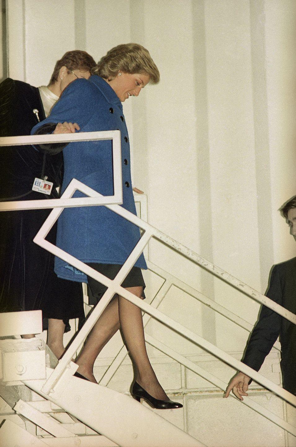 <p>She! has! ARRIVED! Here's Diana walking down some steps at John F. Kennedy International Airport on February 1, 1989. Never wearing sweats on the plane again after witnessing this perfection. </p>