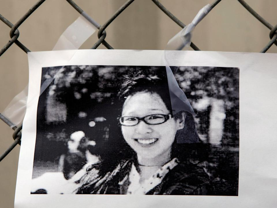 A photocopy showing a photo of Elisa Lam is displayed at a street memorial across the Cecil Hotel in Los Angeles on 21 February 2013 (AP Photo/Damian Dovarganes)