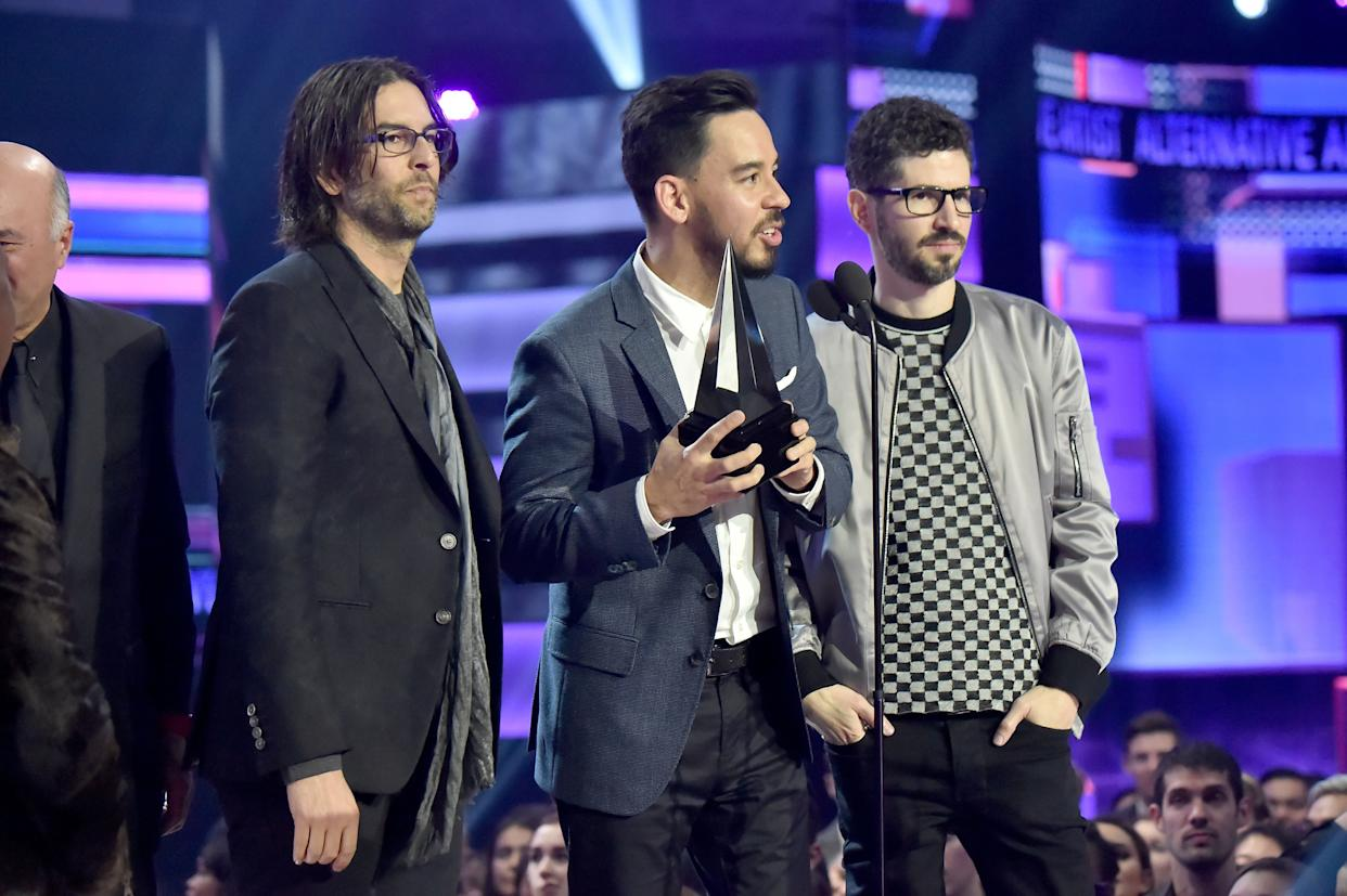 LOS ANGELES, CA - NOVEMBER 19: (L-R) Rob Bourdon, Mike Shinoda, and Brad Delson of the band Linkin Park accept award onstage during the 2017 American Music Awards at Microsoft Theater on November 19, 2017 in Los Angeles, California. (Photo by Jeff Kravitz/AMA2017/FilmMagic for dcp)