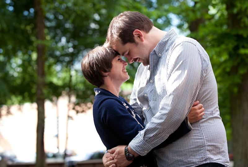 This May 25, 2012, photo, shows actor Isaac Lamb and Amy Frankel in Portland, Ore. Lamb joined about 60 people on a small street near his house last week to propose to Frankel. He's pitching it as the world's first lip-synched proposal and there don't appear to be any challengers.  Lamb's marriage proposal notched 5 million hits on YouTube. (AP Photo/The Oregonian, Alysha Beck)  MAGS OUT; NO SALES; TV OUT