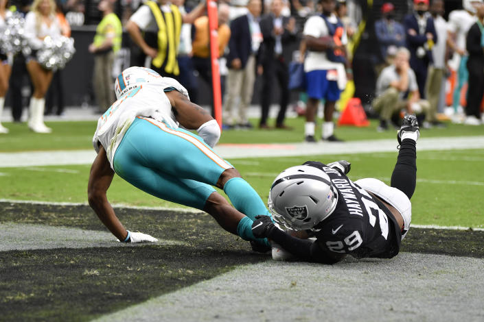 LAS VEGAS, NEVADA - SEPTEMBER 26: Casey Hayward Jr. #29 of the Las Vegas Raiders tackles Jaylen Waddle #17 of the Miami Dolphins in the end zone for a safety in the first quarter of the game at Allegiant Stadium on September 26, 2021 in Las Vegas, Nevada. (Photo by Chris Unger/Getty Images)