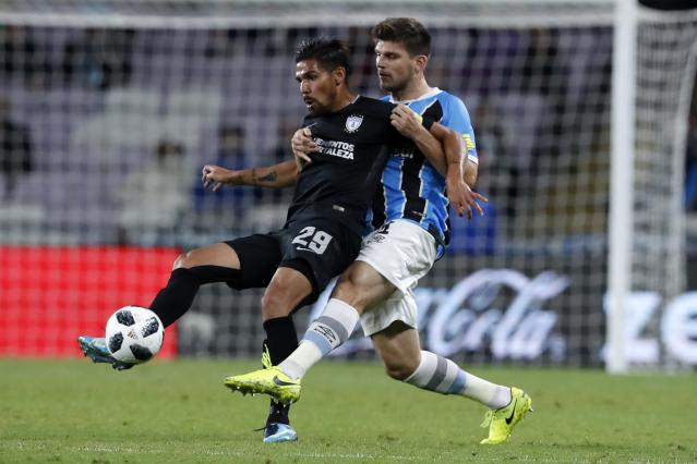 Mexico's Pachuca Franco Jara, left, and Brazil's Gremio Walter Kannemann fight for the ball during the Club World Cup semifinal soccer match between Gremio and Pachuca at the Hazza Bin Zayed stadium in Al Ain, United Arab Emirates, Tuesday, Dec. 12, 2017. (AP Photo/Hassan Ammar)