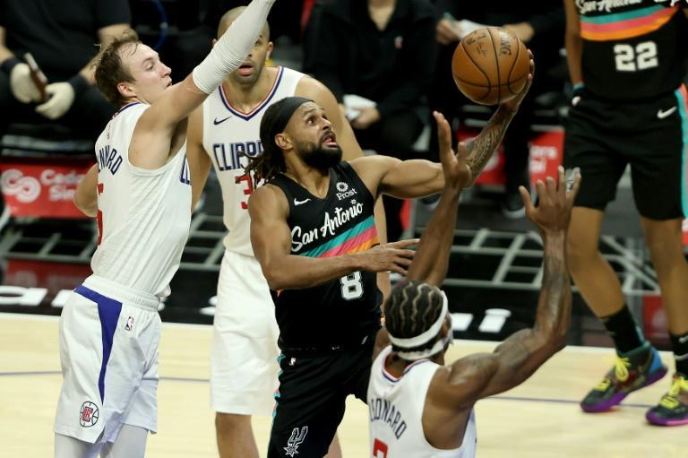 San Antonio's Patty Mills drives to the basket in the Spurs' 116-113 NBA victory over the Los Angeles Clippers