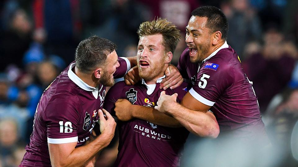 Seen here, Cameron Munster celebrates a try for the Maroons in Origin Game I.