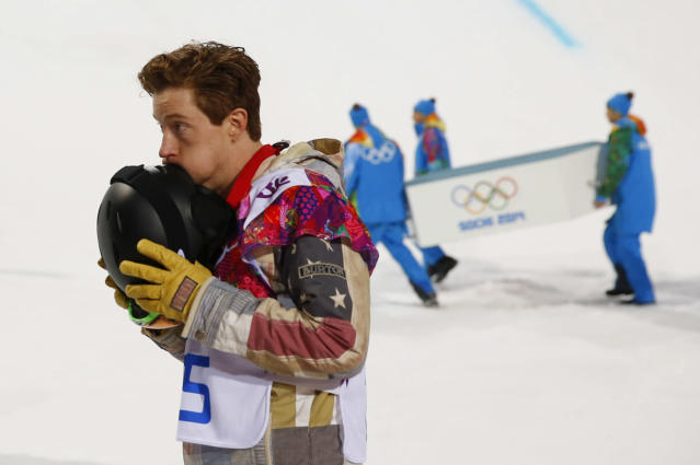 Shaun White of the U.S. reacts after the men's snowboard halfpipe final at the Sochi 2014 Winter Olympic Games, in Rosa Khutor February 11, 2014. American snowboarder Shaun White, one of biggest draws at the Winter Olympics and favourite to win his third straight halfpipe title, bowed out without a medal on Tuesday in the biggest upset of the Games so far. REUTERS/Lucas Jackson (RUSSIA - Tags: SPORT OLYMPICS SPORT SNOWBOARDING TPX IMAGES OF THE DAY) ATTENTION EDITORS: PICTURE 01 OF 24 FOR PACKAGE 'SOCHI - EDITOR'S CHOICE' TO FIND ALL IMAGES SEARCH 'EDITOR'S CHOICE - 11 FEBRUARY 2014'
