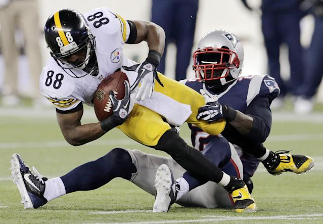 New England Patriots cornerback Kyle Arrington, right, tackles Pittsburgh Steelers wide receiver Emmanuel Sanders (88) in the fourth quarter of an NFL football game Sunday, Nov. 3, 2013, in Foxborough, Mass. The Patriots won 55-31. (AP Photo/Charles Krupa)