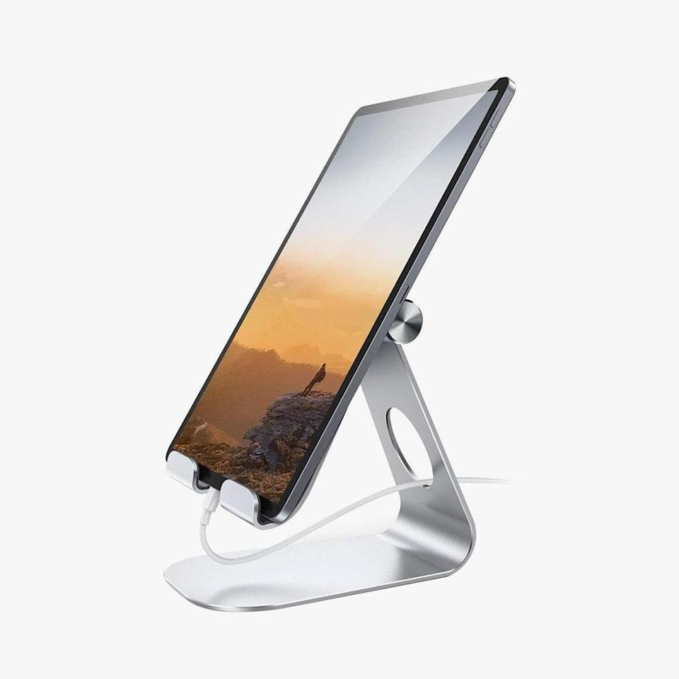 "I didn't realize just how much this iPad stand was going to change my at-home lifestyle when I bought it. From helping to create a second screen when I'm working on my laptop to being the perfect cooking companion, this is the best 20 bucks I've spent in 2020. $22, AMAZON. <a href=""https://www.amazon.com/Tablet-Stand-Adjustable-Lamicall-Reader/dp/B01DBV1OKY/ref=sxts_sxwds-bia-wc-drs-ajax3_0?cv_ct_cx=adjustable+tablet+holder+stand&dchild=1&gclid=EAIaIQobChMInpaLncaj7AIVC4vICh3GggaiEAAYASAAEgK7u_D_BwE&hvadid=322115776483&hvdev=c&hvlocphy=9004577&hvnetw=g&hvqmt=b&hvrand=13182993819442364229&hvtargid=kwd-413982362803&hydadcr=24608_11043388&keywords=adjustable+tablet+holder+stand&pd_rd_i=B01DBV1OKY&pd_rd_r=d80e353f-b9d8-4dfb-897a-69ded9d01754&pd_rd_w=L2Kd9&pd_rd_wg=UrO70&pf_rd_p=2af54486-024b-43c2-a014-77f8e1ab2526&pf_rd_r=M0W9AW1CST82ZVEB9G1M&psc=1&qid=1602110380&sr=1-3-25b07e09-600a-4f0d-816e-b06387f8bcf1&tag=googhydr-20"" rel=""nofollow noopener"" target=""_blank"" data-ylk=""slk:Get it now!"" class=""link rapid-noclick-resp"">Get it now!</a>"