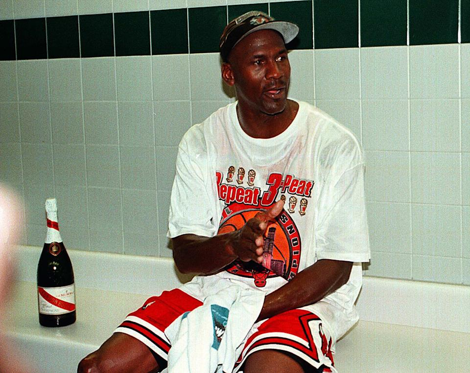 Michael Jordan in the locker room looking exhausted after winning his sixth NBA title on June 14, 1998. (Charles Cherney/Chicago Tribune/Tribune News Service via Getty Images)