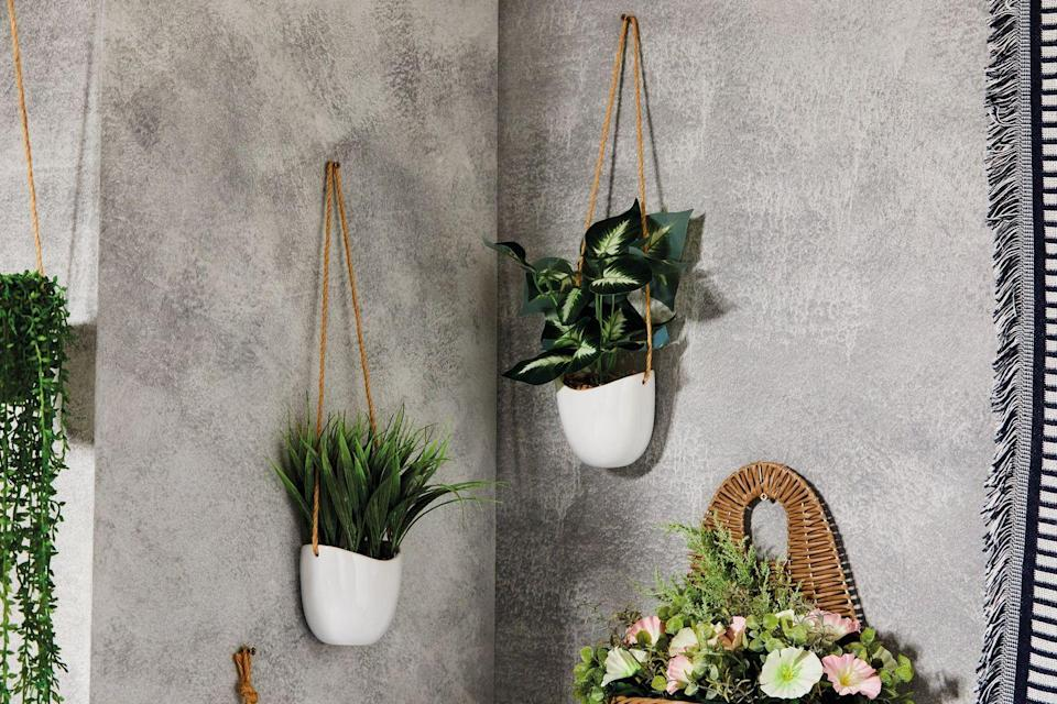 """<p>Spruce up an empty wall space outside with Aldi's minimal white <a href=""""https://www.countryliving.com/uk/homes-interiors/interiors/a32104578/best-indoor-hanging-plants/"""" rel=""""nofollow noopener"""" target=""""_blank"""" data-ylk=""""slk:planters"""" class=""""link rapid-noclick-resp"""">planters</a>, which hang from jute string. Perfect for showing off your favourite foliage. </p><p><a class=""""link rapid-noclick-resp"""" href=""""https://www.aldi.co.uk/c/specialbuys/garden-shop"""" rel=""""nofollow noopener"""" target=""""_blank"""" data-ylk=""""slk:SHOP NOW"""">SHOP NOW</a></p>"""