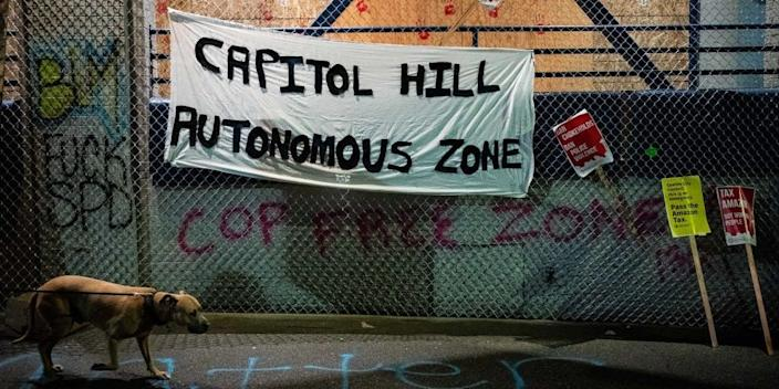 "Capitol Hill Autonomous Zone"" sign hangs on the exterior of the Seattle Police Departments East Precinct on June 9, 2020 in Seattle, Washington."
