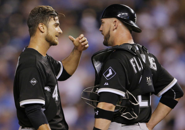 Chicago White Sox starting pitcher Andre Rienzo, left, talks with catcher Tyler Flowers (21) during the sixth inning of a baseball game against the Kansas City Royals at Kauffman Stadium in Kansas City, Mo., Tuesday, May 20, 2014. (AP Photo/Orlin Wagner)