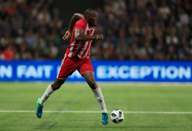 Soccer Football - France 98 v FIFA 98 Selection - U Arena Stadium, Nanterre, France - June 12, 2018 FIFA 98's Usain Bolt in action REUTERS/Gonzalo Fuentes
