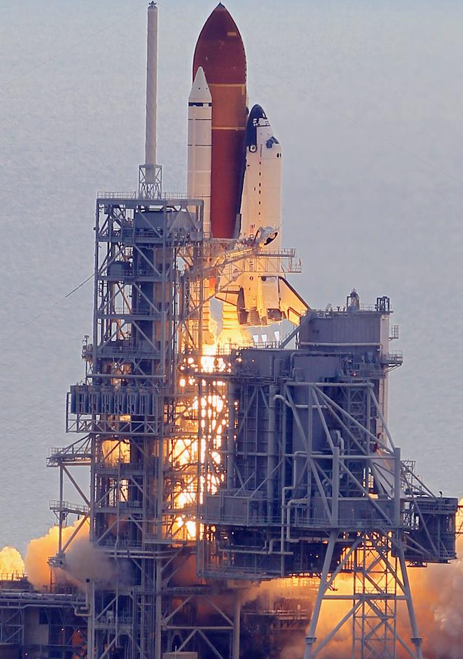 CAPE CANAVERAL, FL - MAY 16:  NASA space shuttle Endeavour lifts off from Launch Pad 39A at the Kennedy Space Center on May 16, 2011 in Cape Canaveral, Florida. After 20 years, 25 missions and more than 115 million miles in space, Endeavour is on its final flight to the International Space Station before being retired and donated to the California Science Center in Los Angeles. Capt. Mark E. Kelly, Gabrielle Giffords's husband, will lead mission STS-134 as it delivers the Express Logistics Carrier-3 (ELC-3) and the Alpha Magnetic Spectrometer (AMS-2) to the International Space Station.  (Photo by Joe Raedle/Getty Images)