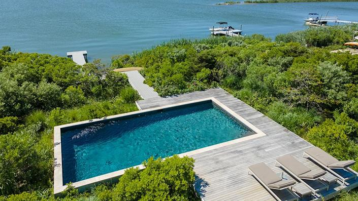 The pool and the path leading down to the private pier. - Credit: Photo: Courtesy of Compass