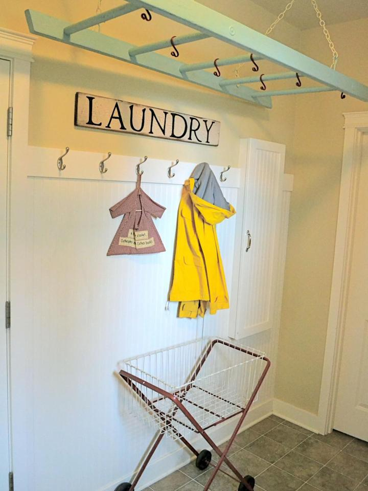 """<p>Laundry can take over your entire house. <a href=""""http://www.littlelucylu.com/"""">Rebecca Kuenzi</a> solved that problem by hanging an old ladder from her ceiling, allowing her to dry her clothes in once place rather than scattered throughout her house.</p>"""