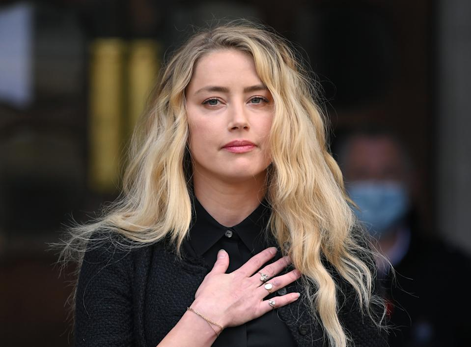 LONDON, ENGLAND - JULY 28: Amber Heard gives a statement after the libel case at the Royal Courts of Justice, the Strand on July 28, 2020 in London, England. Hollywood Actor Johnny Depp is suing News Group Newspapers (NGN) and the Sun's executive editor, Dan Wootton, over an article published in 2018 that referred to him as a