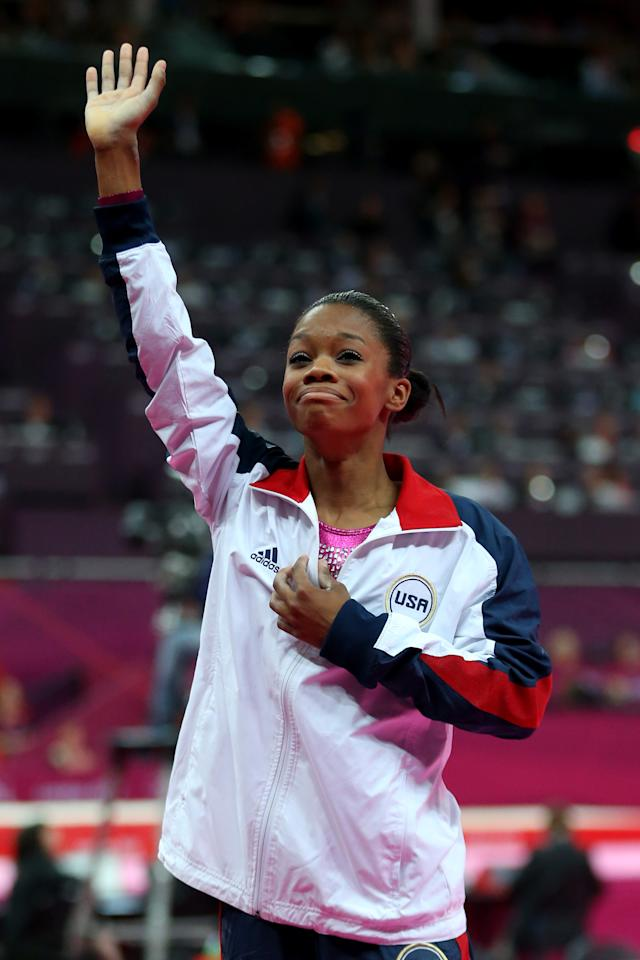 Gabrielle Douglas of the United States waves to the crowd after Douglas wins the gold medal in the Artistic Gymnastics Women's Individual All-Around final on Day 6 of the London 2012 Olympic Games at North Greenwich Arena on August 2, 2012 in London, England.  (Photo by Streeter Lecka/Getty Images)