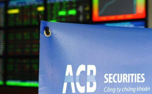 A digital screen flashing shares' prices at a local Asian Commercial Bank (ACB) securities trading floor in Hanoi
